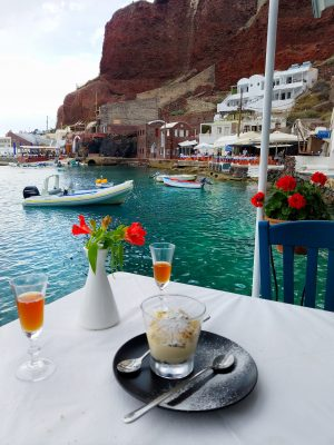 Sunset Taverna oia santorini greece ammoundi bay