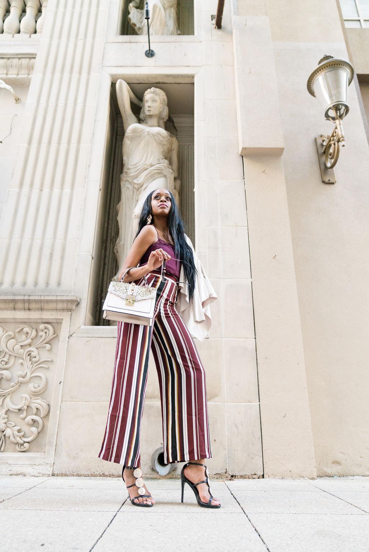 Black women street style burgundy lace cami wide leg stripe pants fall fashion trend